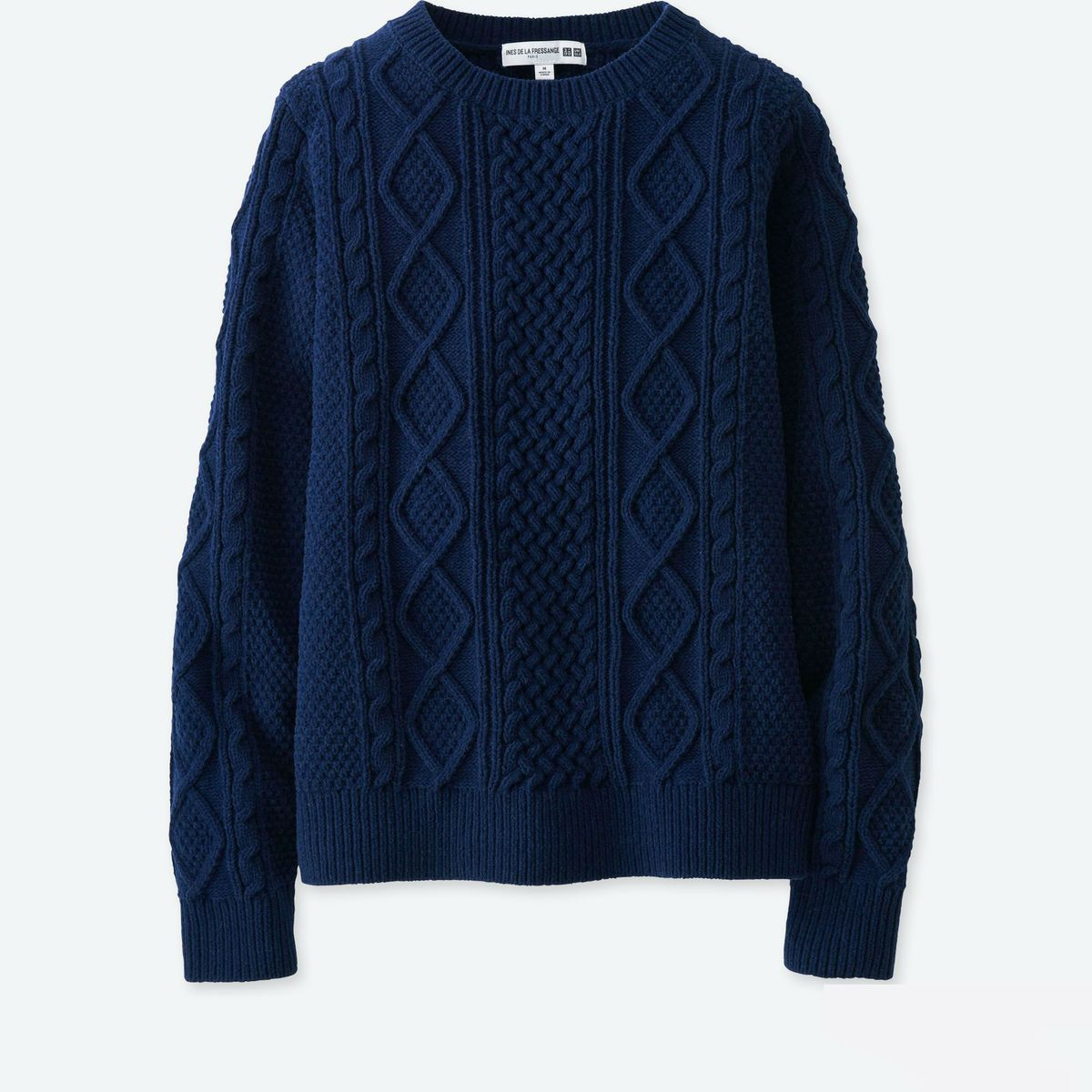 A navy cable knit sweater