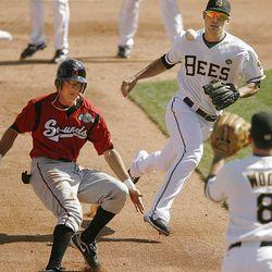 Salt Lake's Sean Rodriquez and Brandon Wood catch Nashville's Johnny Raburn in a hotbox Sunday at Spring Mobile Ballpark.