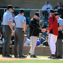 Kirk Gibson and Walt Weiss of the Colorado Rockies meet at the plate.