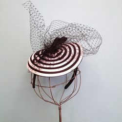"""""""You'll score a bullseye with this hat. Tilt it over one eye to add an extra aura of flirty mystery!"""" ($42)"""