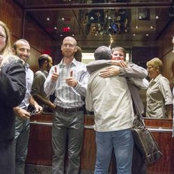 Derek Kitchen gives a thumbs up from inside an elevator as they leave their press conference Monday, Oct. 6, 2014, in the office of Peggy Tomsic in Salt Lake City, after the Supreme Court refused to hear appeals on same sex marriages, making them legal.