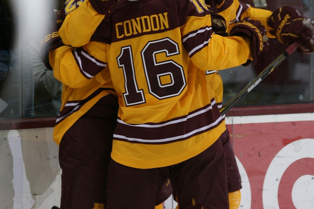 Nathan Condon, who scored three times against UMD, celebrating a Gophers goal (photo courtesy of Paul Rovnak)