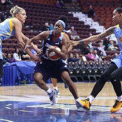 Atlanta Dream's Tiffany Hayes splits the defense of Chicago Sky's Elena Delle Donne (11) and Tamera Young (11).