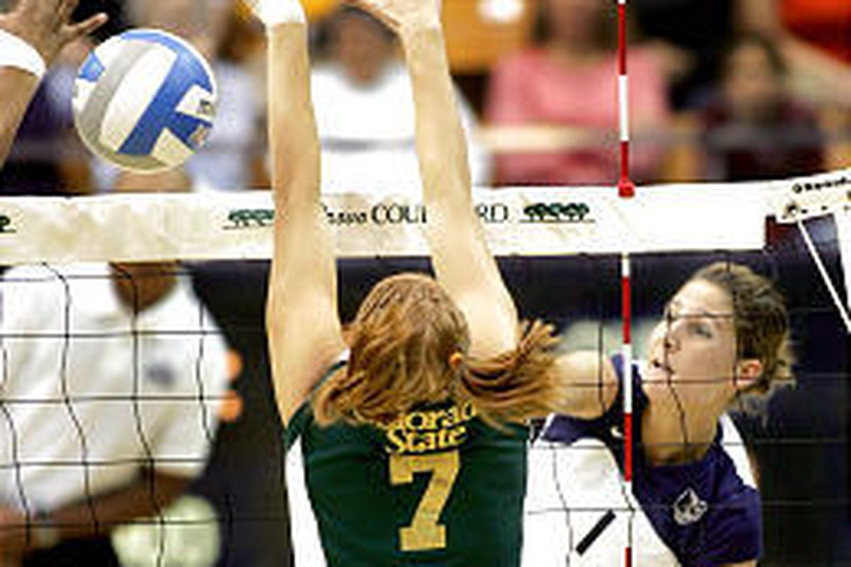 BYU's Chelsea Goodman hits the ball past CSU's Tonya Mokelki in the Cougars' 3-2 loss to Colorado State on Friday at the Marriott Center.