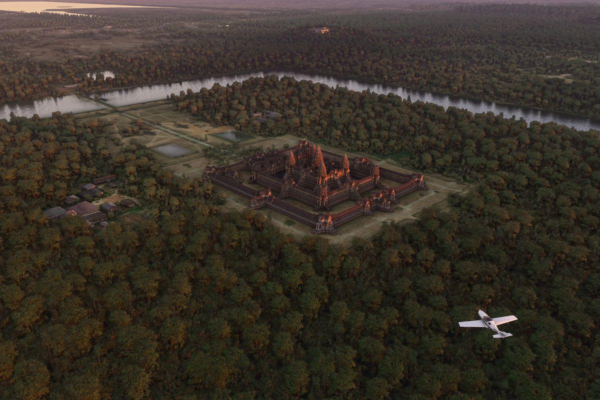 a white plane flies over Cambodia's Angkor Wat in Microsoft Flight Simulator