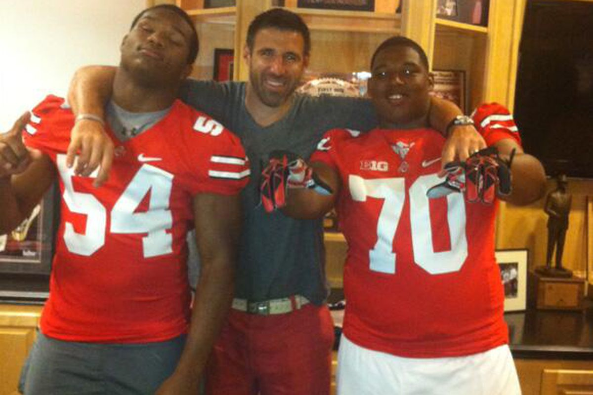 '14 DE Da'Shawn Hand and '15 DT Tim Settle both put on Ohio State's jerseys.