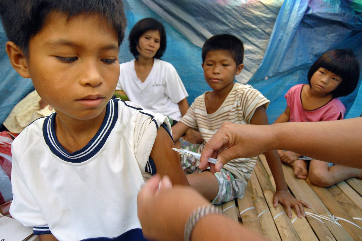 Getting a measles-vaccination shot in Mallipot, in the Phillipines.