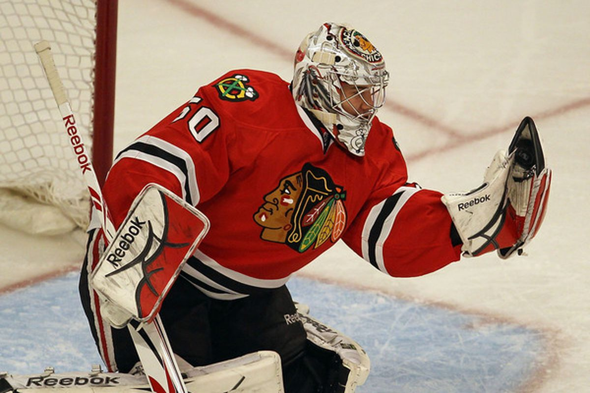 Corey Crawford of the Chicago Blackhawks makes a glove save against the Florida Panthers at the United Center on March 23, 2011 in Chicago, Illinois. (Photo by Jonathan Daniel/Getty Images)