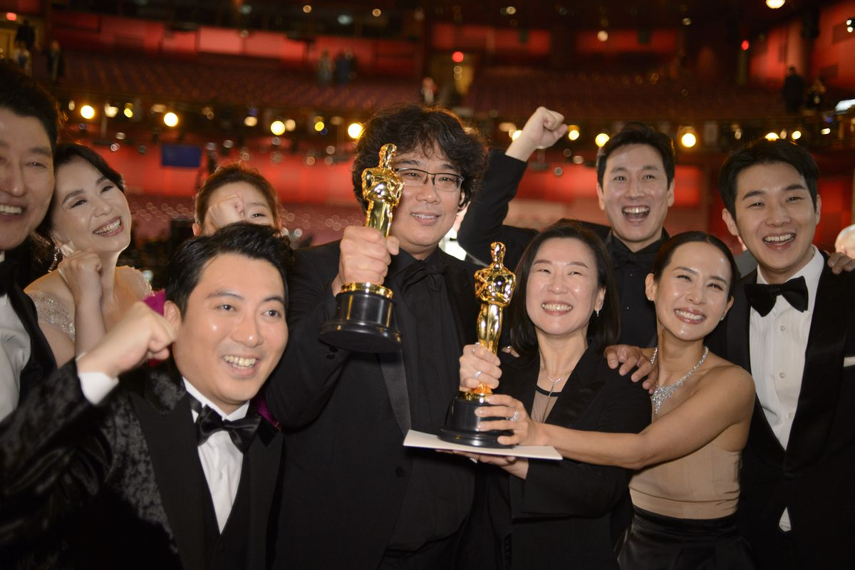 Bong Joon-ho, cast, and producers of Parasite holding their Oscars at the 92nd Academy Awards in Hollywood.