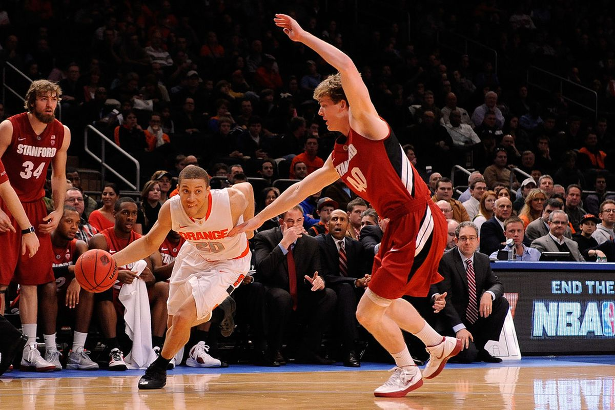 John Gage, who scored a career-high 10 points off the bench, defends Syracuse's Brandon Triche during the Cardinal's 69-63 loss to the Orange at Madison Square Garden.