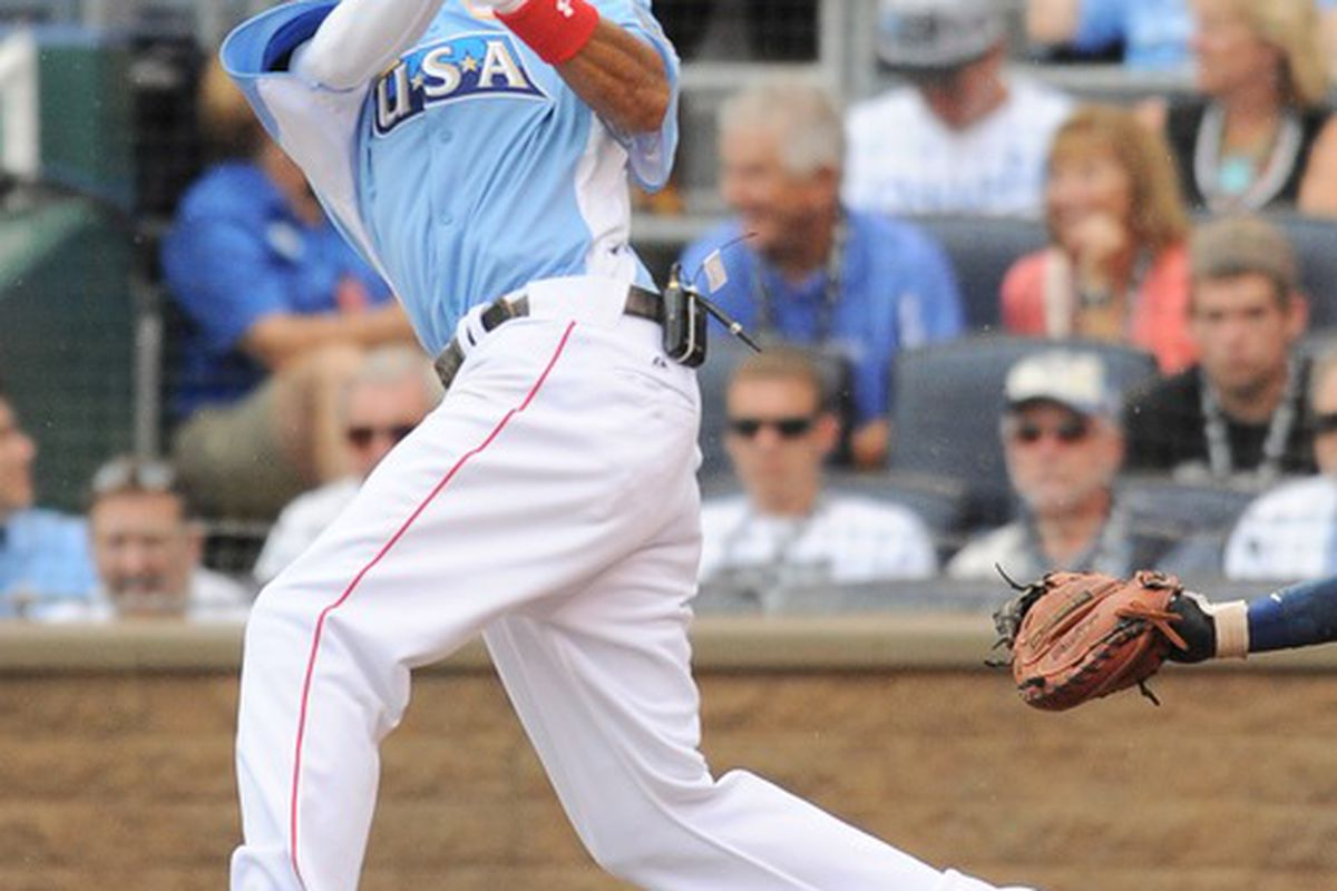 July 8, 2012; Kansas City, MO, USA; USA player Billy Hamilton hits a two-run triple during the third inning of the 2012 All Star Futures Game at Kauffman Stadium.  Mandatory Credit: Denny Medley-US PRESSWIRE