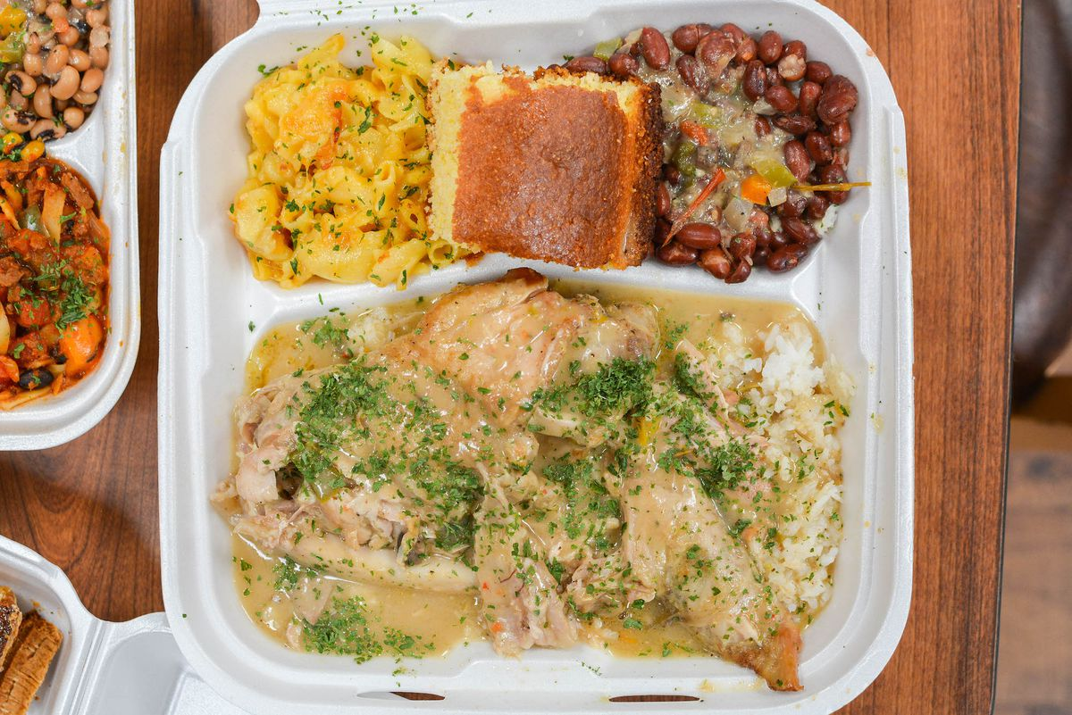 A plate of smothered fried turkey in styrofoam.