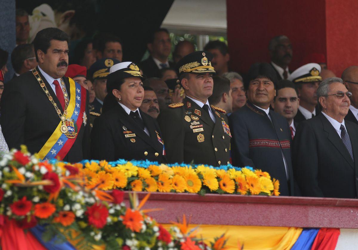 Venezuelan President Nicolas Maduro stands with his military chiefs on March 5, 2014 in Caracas, Venezuela.