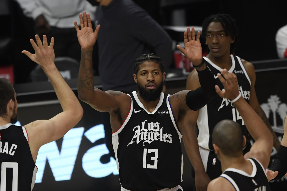Paul George of the Los Angeles Clippers celebrates with his teammates after scoring a basket and getting fouled against Philadelphia 76ers during the first half of the game at Staples Center on March 27, 2021 in Los Angeles, California.