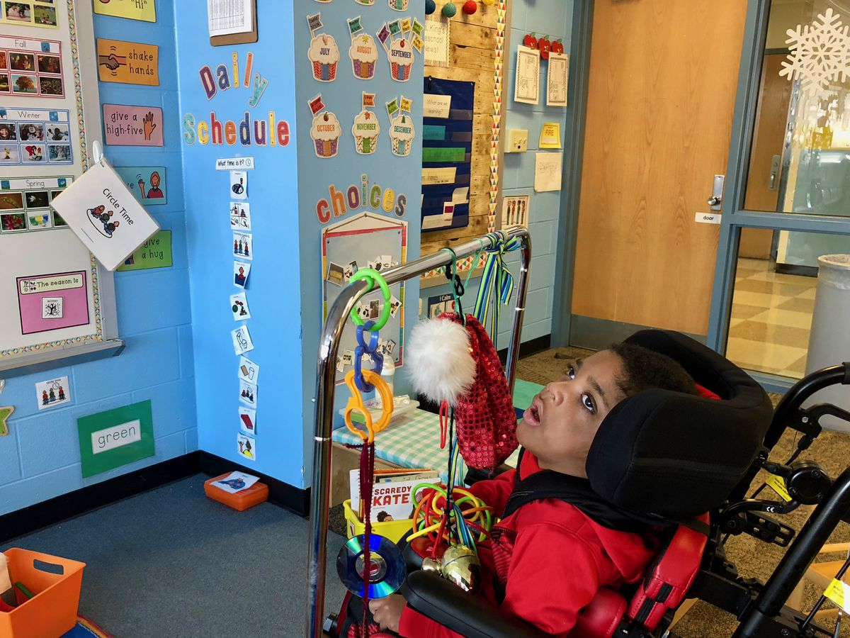 Brayden, a student in Cate King's developmental preschool class at IPS School 48, works with different therapists as part of his education.