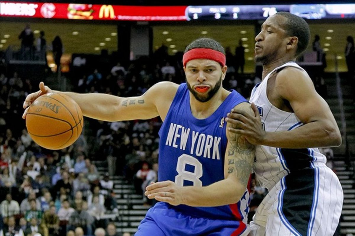 Feb 22, 2012; Newark, NJ, USA;  New Jersey Nets point guard Deron Williams (8) controls the ball as Orlando Magic point guard Chris Duhon (25) defends during the second half at the Prudential Center. The Magic won 108-91. Jim O'Connor-US PRESSWIRE