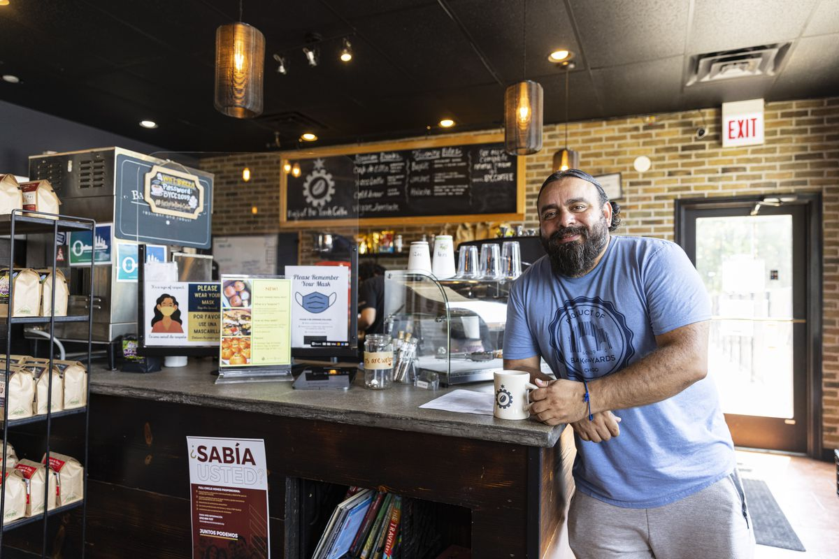 Jesse Iniguez poses for a portrait at his coffee shop Back of the Yards Coffeehouse at 2059 W 47th St in Back of the Yards, Thursday, Aug. 5, 2021.