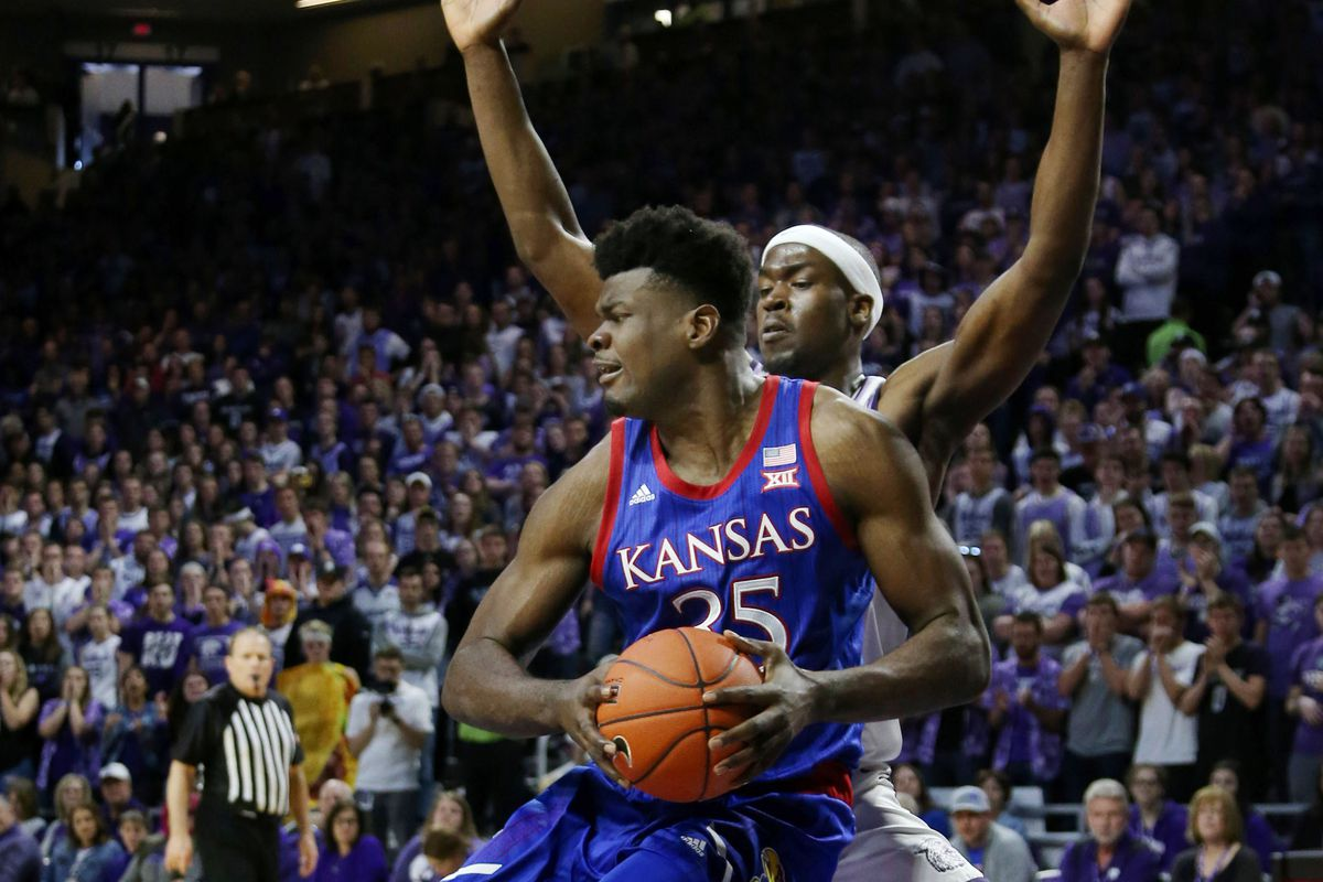 Kansas Jayhawks center Udoka Azubuike is guarded by Kansas State Wildcats forward Makol Mawien during the second half of a game at Bramlage Coliseum.