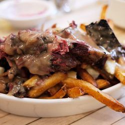 Poutine: Poutine, a signature Canadian dish, consists of French fries covered in cheese curds, gravy, and various other toppings, like the meat above.<br /><br />Found at: Mile End, Shopsin's, The Brindle Room, Bobo, Corner Burger<br /><br />Photo via <a