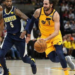 Utah Jazz guard Ricky Rubio (3) drives against Denver Nuggets guard Will Barton (5) at Vivint Smart Home Arena in Salt Lake City on Tuesday, Nov. 28, 2017.