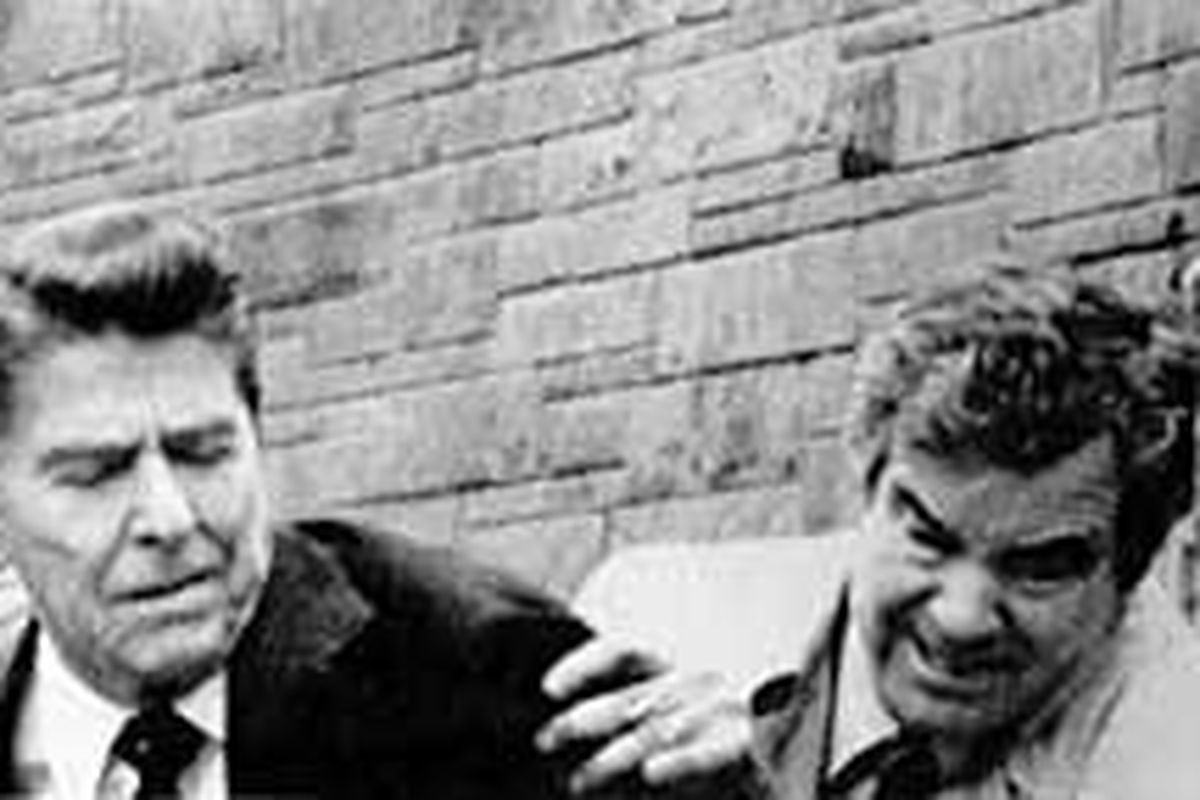 Agent Jerry Parr, right, pushes Ronald Reagan into his limousine after a 1981 assassination attempt in which the president was wounded.