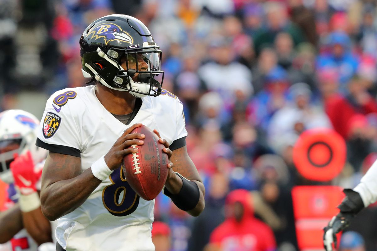 Lamar Jackson of the Baltimore Ravens drops back to throw a pass against the Buffalo Bills at New Era Field on December 8, 2019 in Orchard Park, New York.