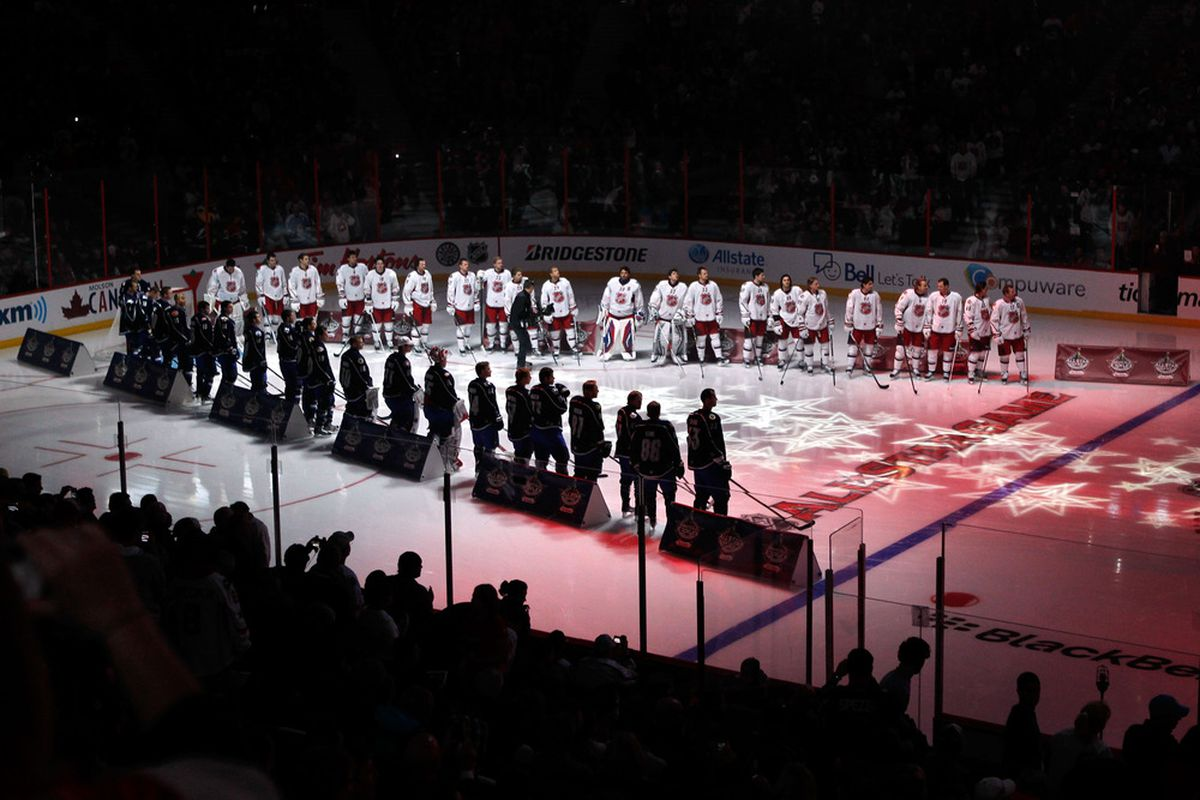 OTTAWA, ON - JANUARY 29:  Team Chara and team alfredsson line up for the performance of the anthem poses prior to the 2012 NHL All-Star Game at Scotiabank Place on January 29, 2012 in Ottawa, Ontario, Canada.  (Photo by Gregory Shamus/Getty Images)