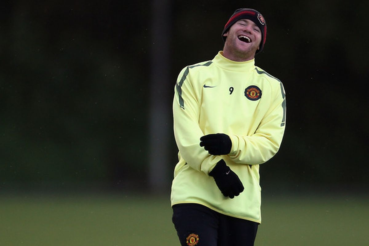 Wayne Rooney has a laugh in training on Monday.