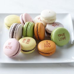 The classic childhood Valentine's Day heart candies get a foodie refresh with the <b>Dana Loia's Conversation Heart Macarons</b>. The box of one dozen macarons contains six delicious, gluten-free flavors with classic mottos reflecting your affection. Orde