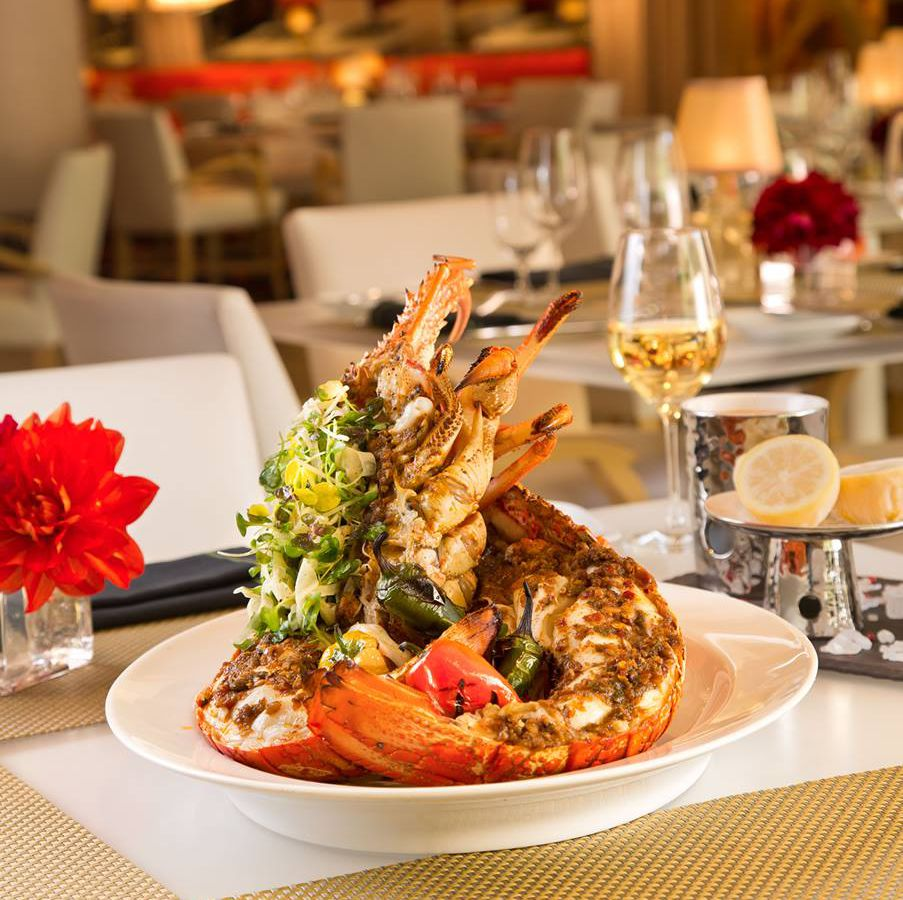 Lakeside's fresh lobster oven-baked simply or with a red chili rub and served with a choice of drawn, yuzu-basil, or spicy harissa butter.