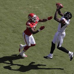 Atlanta Falcons wide receiver Julio Jones (11) catches a touchdown pass while covered by Kansas City Chiefs defensive back Jacques Reeves (35) during the first half of an NFL football game at Arrowhead Stadium in Kansas City, Mo., Sunday, Sept. 9, 2012.