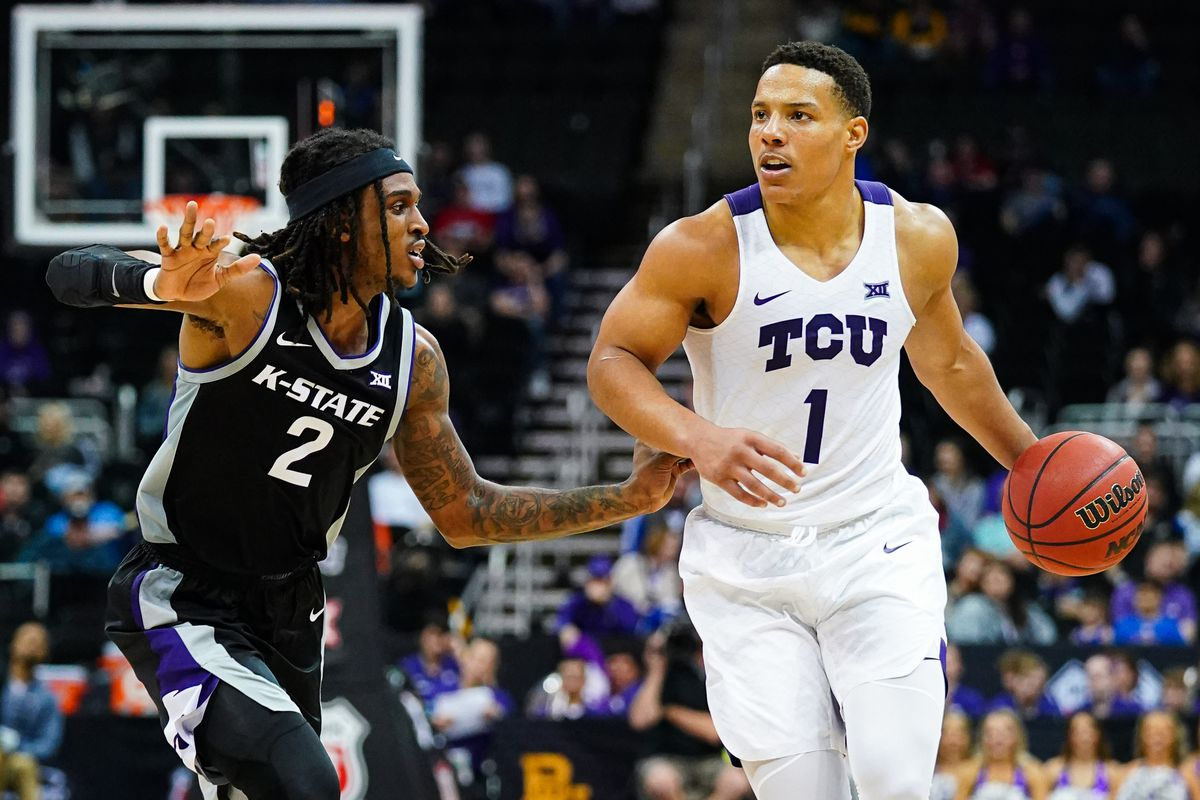 TCU Horned Frogs guard Desmond Bane dribbles against Kansas State Wildcats guard Cartier Diarra  during the second half at Sprint Center.