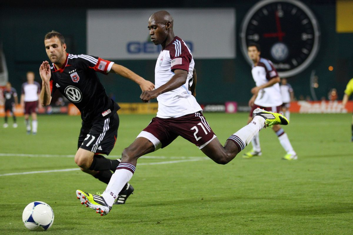 WASHINGTON, DC - MAY 16: Luis Zapata #21 of the Colorado Rapids controls the ball against Daniel Woolard #21 of D.C. United at RFK Stadium on May 16, 2012 in Washington, DC. (Photo by Ned Dishman/Getty Images)