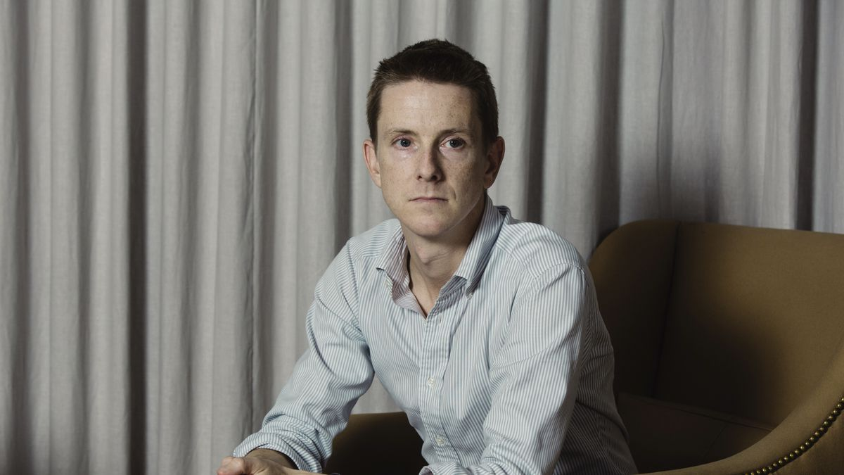 Chris Hughes sits for a portrait in his office.