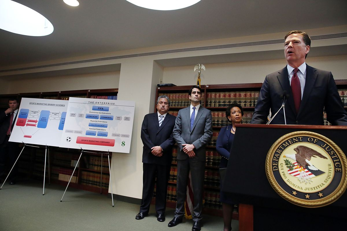 FBI Director James Comey discusses the indictment during a press conference at the DOJ.