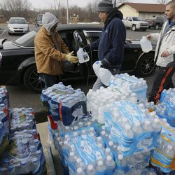 Volunteers load vehicles with bottled water at Our Lady of Guadalupe Church, in Flint, Mich., on Feb. 5, 2016. Flint's lead-contaminated water crisis has affected all of the city's nearly 100,000 residents.