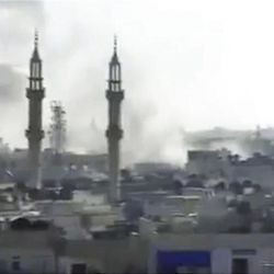 This image made from amateur video released by the Shaam News Network and accessed Tuesday, April 17, 2012, purports to show smoke rising from buildings in Homs, Syria.