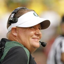 Oregon coach Chip Kelly looks to the scoreboard during the first half of an NCAA college football game against Fresno State in Eugene, Ore., Saturday, Sept. 8, 2012.