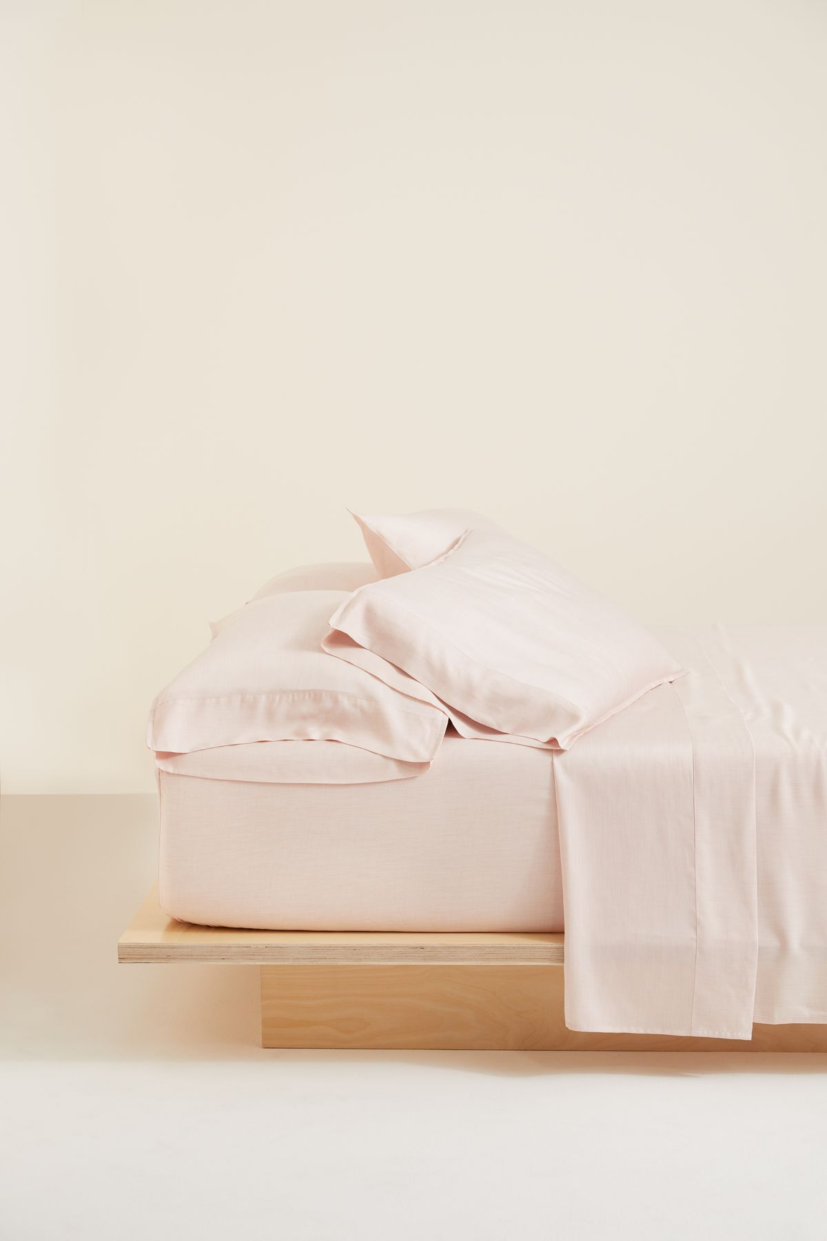 Bed with pink sheets