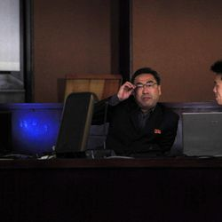 North Korean men wait at the press center in Pyongyang, North Korea, Friday, April 13, 2012. North Korea fired a long-range rocket early Friday, South Korean defense officials said, defying international warnings against a launch widely seen as a provocation.