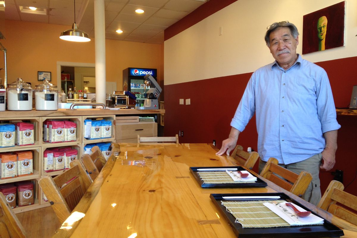 The area behind owner Katsuaki Suzuki is intended to be a community art wall.