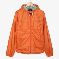 """<strong>Fred Perry</strong> Ripstop Cagoule in Brick Red/Mint Grey, <a href=""""http://www.fredperry.us/men/jackets/ripstop-cagoule-j4252.html"""">$190</a>"""
