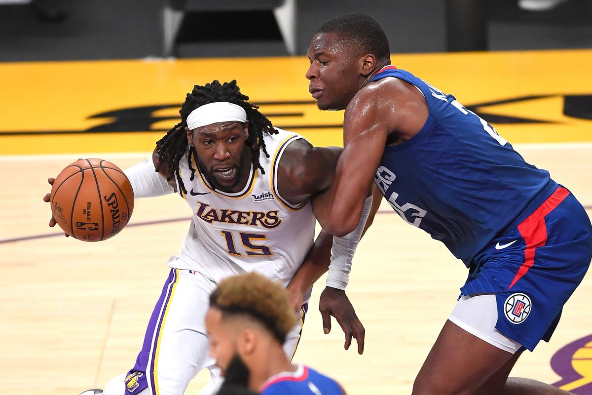 Los Angeles Clippers forward Mfiondu Kabengele defends Los Angeles Lakers center Montrezl Harrell in the second half of the game at Staples Center.