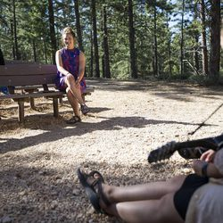 Amy Auble, left, Meleeza Hall and Gabi Sheeley sit and talk before the 9:30 a.m. nondenominational Christian church service in Bryce Canyon National Park, Sunday, June 18, 2017.