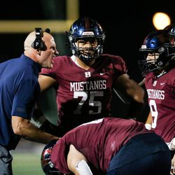 Herriman head coach Dustin Pearce yells at his players during a high school football game at Herriman High School in Herriman on Friday, Sept. 4, 2020.