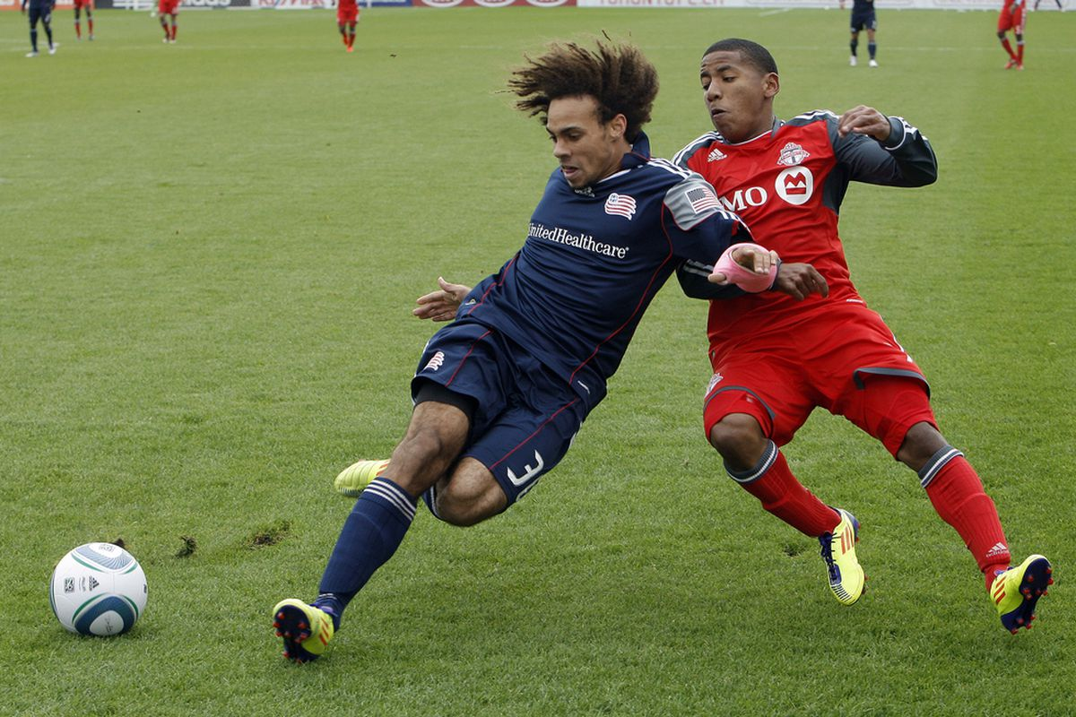 TORONTO, CANADA - OCTOBER 22: Joao Plata #7 of Toronto FC trips up Kevin Alston #30 of New England Revolution during MLS action at BMO Field October 22, 2011 in Toronto, Ontario, Canada. (Photo by Abelimages/Getty Images)