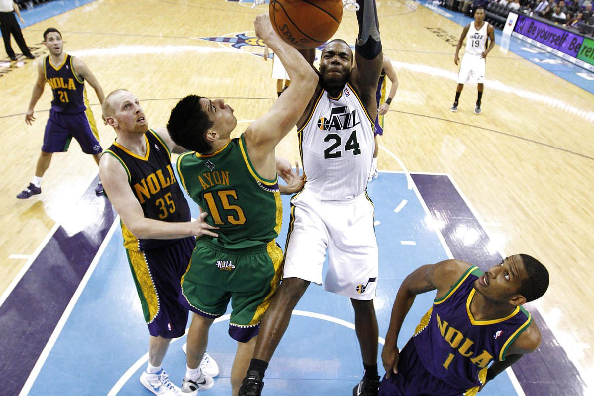 Utah Jazz power forward Paul Millsap (24) dunks the ball over New Orleans Hornets power forward Gustavo Ayon (15) in the second half of an NBA basketball game in New Orleans, Monday, Feb. 13, 2012. The Hornets won their fifth game this season 86-80.(AP Ph