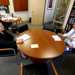 Ivy Estabrooke, executive director of the Utah Science Technology and Research Initiative, meets with USTAR fellow Douglas Weaver at the USTAR office in Salt Lake City on Tuesday, May 30, 2017.