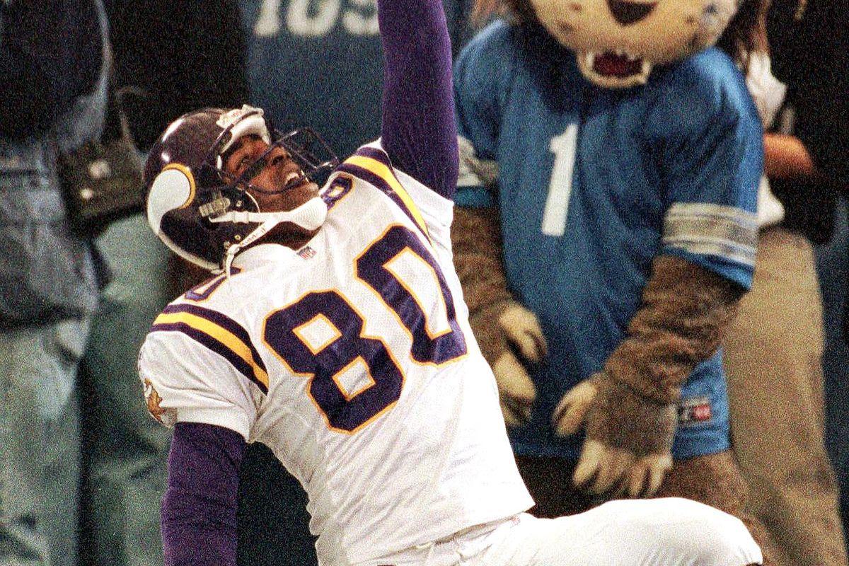 The Detroit Lions team mascot looks on (R) as Minn