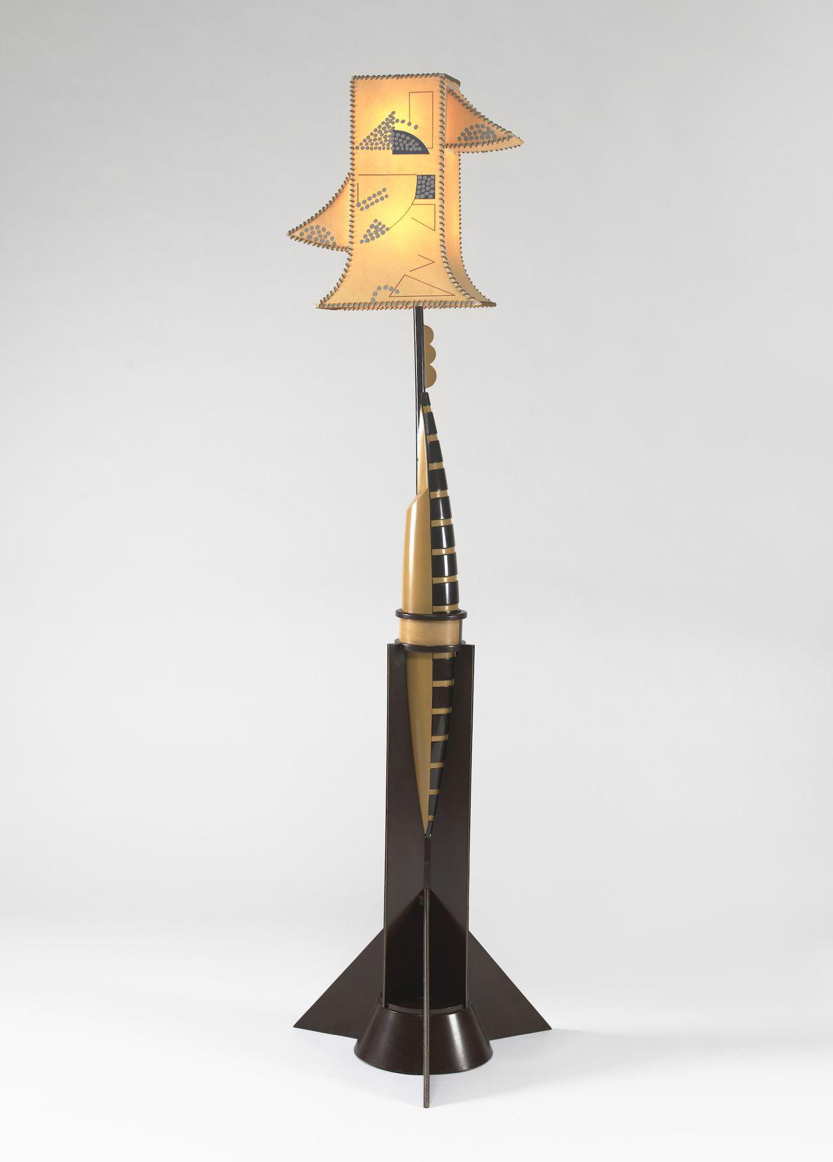 Lamp with an angular base and irregularly shaped shade.